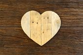stock photo of driftwood  - Love Valentines wooden heart from recycled old palette on rough driftwood background copy space - JPG