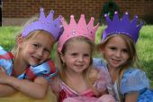 image of toddlers tiaras  - Three cute little girls enjoy playing dress up as princesses - JPG