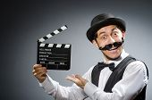 stock photo of clapper board  - Funny man with movie clapper board  - JPG