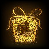 stock photo of eid festival celebration  - Floral decorated golden gift box on brown background for Muslim community festival Eid Mubarak celebrations - JPG