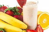 stock photo of fruit shake  - healthy strawberry smoothie with fruits isolated on white background - JPG