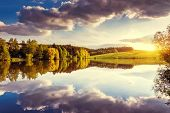 stock photo of wild adventure  - Fantastic panorama of morning lake with cumulus cloud - JPG