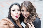 pic of peace  - young girls taking a selfie gesturing kiss and peace sign - JPG