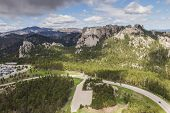 picture of mount rushmore national memorial  - aerial view of Mount Rushmore on a cloudy spring morning - JPG
