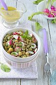 stock photo of chickpea  - Green lentil and chickpea salad with radish and herbs - JPG