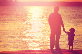 pic of dock a lake  - Father and son  on a dock at sunset - JPG