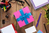 stock photo of office romance  - Gift box and office supplies over office table - JPG