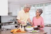 picture of lunch  - Senior couple preparing lunch together at home in the kitchen - JPG