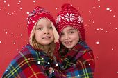 picture of blanket snow  - Festive little girls smiling at camera against snow - JPG