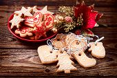 picture of christmas cookie  - Christmas cookies handmade lies on wooden background. Gingerbread reindeer cookies and christmas decoration Christmas tree