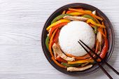 foto of chopsticks  - Rice with chicken vegetables and chopsticks close - JPG