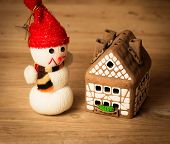 picture of gingerbread house  - gingerbread house over and lovely handmade snowman - JPG