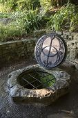 stock photo of chalice  - The Chalice Well also known as the Red Spring is a well situated at the foot of Glastonbury Tor in the county of Somerset England - JPG