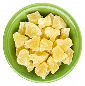 image of ceramic bowl  - chunks of dried pineapple in an isolated green ceramic bowl - JPG