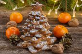 picture of tangerine-tree  - two  gingerbread  tree with fresh tangerines on wooden  background - JPG
