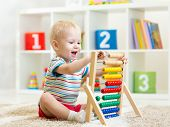 pic of pretty-boy  - happy kid boy playing with abacus toy indoors - JPG