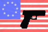 foto of civil war flags  - American Flag With A Silhouette Of A Hand Gun - JPG