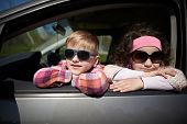 picture of driving school  - little pretty girl and cute boy driving fathers car - JPG
