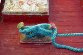 foto of node  - Mooring node closeup on wooden deck of a boat - JPG