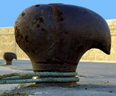 foto of bollard  - Thick Rope Securely Tied around Bollard at the Harbor - JPG