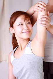 foto of chiropractic  - woman getting chiropractic in the chiropractic office  - JPG