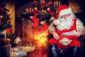 pic of letters to santa claus  - Santa Claus reading letters from children - JPG