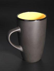 image of loamy  - Photo of the Black mug over black background - JPG