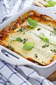 foto of lasagna  - Healthy zucchini lasagna bolognese in a baking dish - JPG