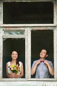 picture of boutonniere  - cheerful wedding couple having fun outdoors on wedding day - JPG