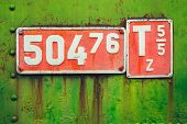 foto of railroad-sign  - Old sign with engine parameters of a narrow - JPG