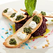stock photo of pesto sauce  - Beetroot Salad with Dried Crust and Pesto Sauce - JPG