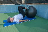 stock photo of hamstring  - Stability ball used to strengthen the hamstrings - JPG