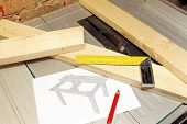 stock photo of draft  - wooden planks with tools and table draft on tablesaw - JPG