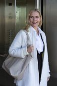 foto of elevators  - blond woman coming out of an elevator - JPG