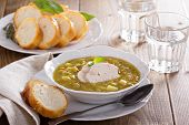 stock photo of peas  - Hearty and thick chicken split pea soup - JPG