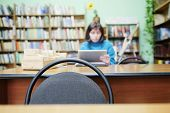 picture of librarian  - Librarian working in the library - JPG