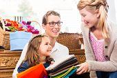 stock photo of handicrafts  - Family buying supplies  in handicraft store - JPG