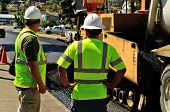 foto of engineering construction  - Engineer and site boss discussing a repaving construction project - JPG
