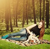 picture of siberian husky  - Siberian Husky dog puppy playing with young happy woman outdoor - JPG