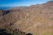 stock photo of curvy  - Masca village from above with scenic curvy road Tenerife Spain - JPG