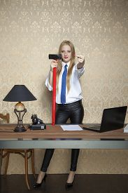 pic of ugly  - business woman with a big hammer shows the ugly gesture - JPG