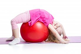 picture of pilates  - Cute kid girl stretching on pilates fitness ball - JPG