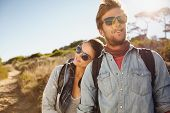 Young Hiking Couple Enjoying Nature poster