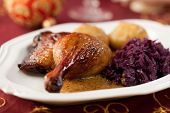 picture of roast duck  - Roast duck legs with potato dumplings and red cabbage for christmas - JPG