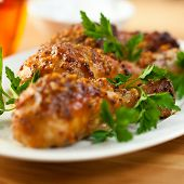 Roast chicken glazed with honey and french mustard