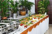 stock photo of chafing  - banquet table with chafing dish heaters - JPG