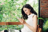 Confident Young Asian Woman In Smart Casual Wear Using Smartphone, Typing On Phone. poster