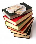 Money over book stack.  Education  concept