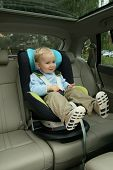 image of seatbelt  - 18 months old baby boy in car safety seat - JPG