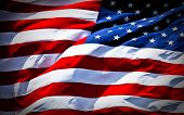 foto of american flags  - an american flag boldly flying in the wind - JPG